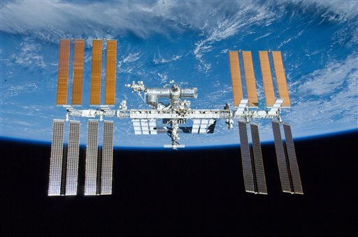 In this image provided by NASA the International Space Station is shown with the backdrop of Earth.