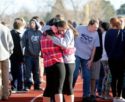 Students comfort each other at Arapahoe High School in Centennial, Colo., on Friday, Dec. 13, 2013, where a student shot at least one other student at a Colorado high school Friday before he apparently killed himself, authorities said. (AP)
