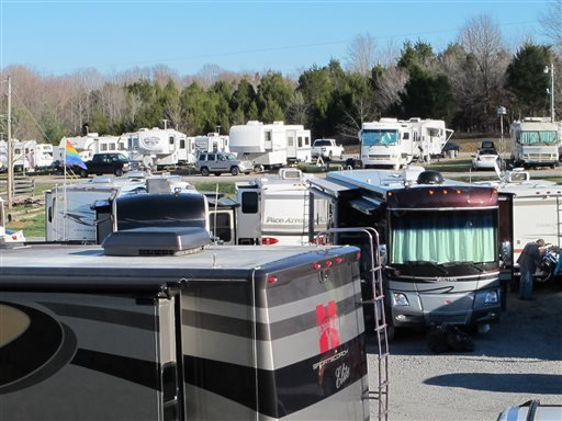 RVs are lined up at the Green River Stables campground near Campbellsville, Ky., which has become a Christmas-season tradition. The Amazon.com facility nearby recruits RV owners to come in as seasonal workers to help fill holiday orders.
