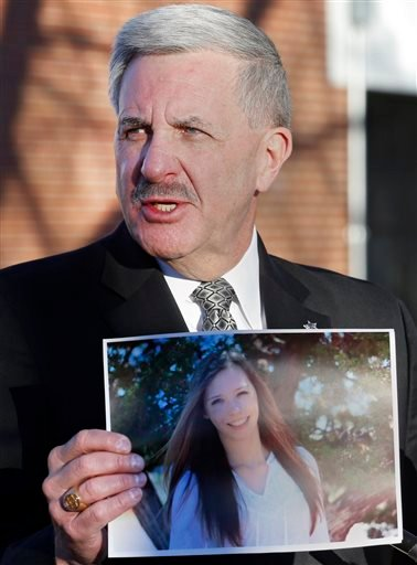 Arapahoe County Sheriff Grayson Robinson holds a picture of Claire Davis the 17-year-old student that was shot during a briefing Saturday, Dec. 14, 2013, at Arapahoe High School in Centennial, Colo.
