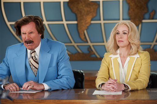 """This photo provided by Paramount Pictures shows Will Ferrell, left, as Ron Burgundy and Christina Applegate as Veronica Corningstone, in a scene from the film, """"Anchorman 2: The Legend Continues."""""""
