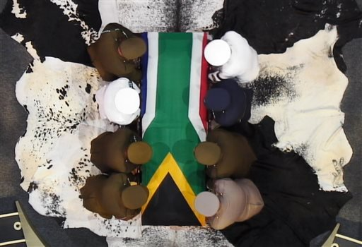 In this video frame grab, military officers prepare to lift South African President Nelson Mandela's casket following his funeral service in Qunu, South Africa, Sunday, Dec. 15, 2013. (AP Photo/SABC)