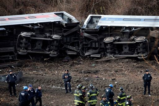 In this Dec. 1, 2013 file photo, emergency personnel respond to the scene of a Metro-North passenger train derailment in the Bronx borough of New York.
