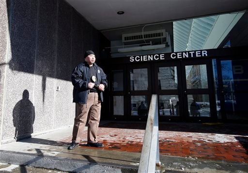 A security officer guards an entrance at the Science Center at Harvard University in Cambridge, Mass., Monday, Dec. 16, 2013.