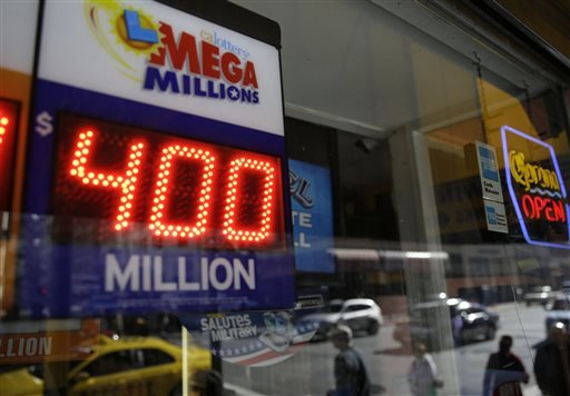 This Dec. 12, 2013 file photo shows a sign displaying the current Mega Millions jackpot at a Financial District liquor store in San Francisco.