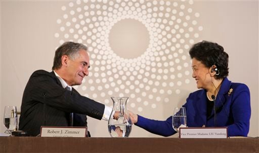 In this Nov. 18, 2013 file photo, University of Chicago president Robert J. Zimmer, left, shakes hands with Vice Premier Liu Yandong of China, after she finished her remarks at the U.S.-China University Presidents Roundtable at the University of Chicago.