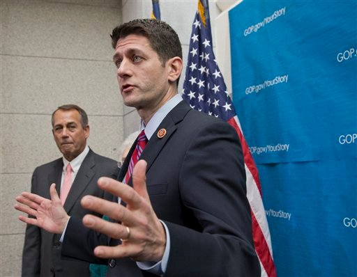 This photo taken Dec. 11, 2013 shows House Budget Committee Chairman Rep. Paul Ryan, R-Wis., right, accompanied by House Speaker John Boehner of Ohio speaking during a news conference on Capitol Hill in Washington.
