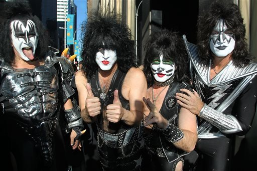 """FILE - This Oct. 11, 2012 file image released by Starpix shows, from left, Gene Simmons, Paul Stanley, Eric Singer, Tommy Thayer of KISS as the band arrives at SiriusXM offices to promote their latest release """"Monster,"""" in New York. (AP)"""