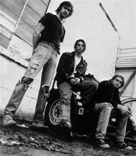 FILE - This 1991 file photo shows the band Nirvana, from left, Krist Novoselic, Dave Grohl, and Kurt Cobain. Nirvana will be inducted into the 2014 Rock and Roll Hall of Fame on April 10, 2014, at the Barclays Center in New York. (AP Photo)