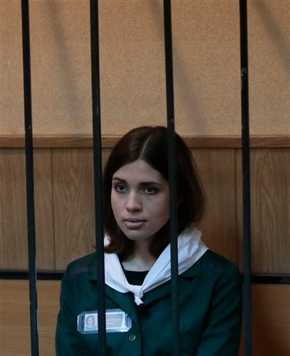 April 26, 2013 file photo: Nadezhda Tolokonnikova, a member of the feminist punk band Pussy Riot sits behind bars at a district court in Zubova Polyana southeast of Moscow in Russia's province of Mordovia. (AP Photo/Mikhail Metzel, File)