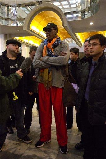 Former NBA basketball star Dennis Rodman speaks to the media as he enters the Koryo Hotel in Pyongyang, North Korea Thursday, Dec. 19, 2013.