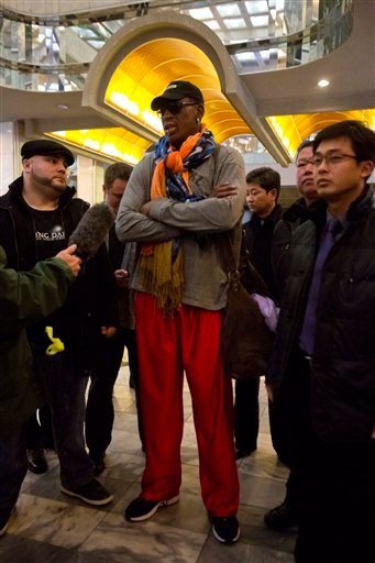 Former NBA basketball star Dennis Rodman speaks to the media as he enters the Koryo Hotel in Pyongyang, North Korea Thursday, Dec. 19, 2013.