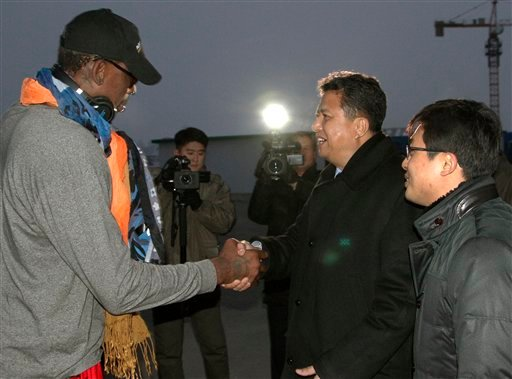 Former NBA basketball star Dennis Rodman shakes hands with Vice Minister of North Korea's Sports Ministry, Son Kwang Ho, as Rodman arrives at the international airport in Pyongyang, North Korea on Thursday, Dec. 19, 2013.