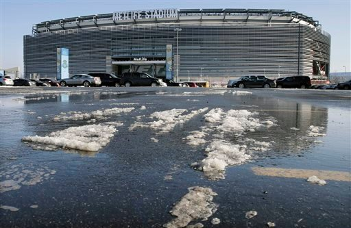 Snow and slush left from Tuesday's snowfall is seen outside MetLife stadium in East Rutherford, N.J., Wednesday, Dec. 18, 2013. (AP)