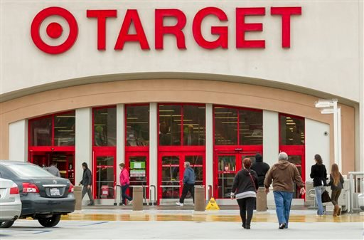 Shoppers arrive at a Target store in Los Angeles on Thursday, Dec. 19, 2013.