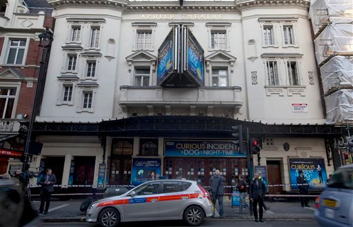 Police stand outside The Apollo Theatre in London, Friday, Dec. 20, 2013.