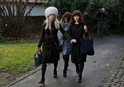 Italian sisters Francesca, right, and Elisabetta Grillo, background centre, former personal assistants of English broadcaster Nigella Lawson and her former husband art collector Charles Saatchi, arrive at the Isleworth Crown Court, in west London, Friday.