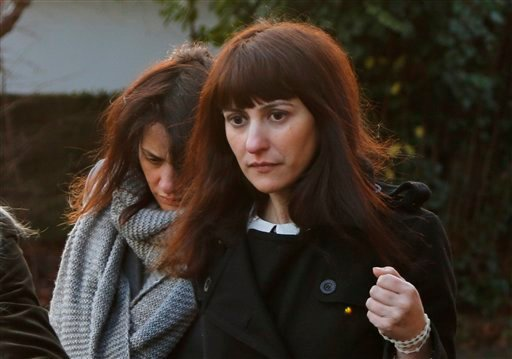 Italian sisters Francesca, right, and Elisabetta Grillo, left, former personal assistants of English broadcaster Nigella Lawson and her former husband art collector Charles Saatchi, arrive at the Isleworth Crown Court