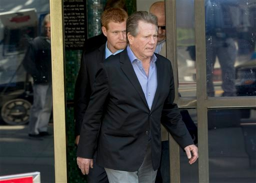 This Dec. 12, 2013 file photo shows actor Ryan O'Neal, center, followed by his son, Redmond O'Neal, as they exit court for a lunch break in Los Angeles.