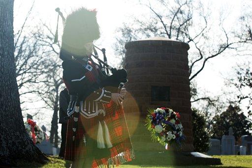"""Bag piper Ray Bilter, plays """"Amazing Grace"""" near the Pan Am Flight 103 memorial cairn at Arlington National Cemetery, in Arlington, Va., Saturday, Dec. 21, 2013."""