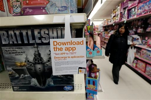 In this Thursday, Nov. 28, 2013, photo, a sign for a shopping application is placed at the toys section in Kmart, in New York.