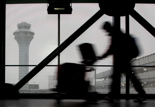 A traveler walks through Terminal 3 at O'Hare International Airport in Chicago on Saturday, Dec. 21, 2013.