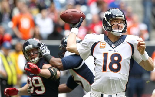 Denver Broncos quarterback Peyton Manning (18) drops back to pass during the first half of an NFL football game against the Houston Texans, Sunday, Dec. 22, 2013, in Houston. (AP Photo/The Courier, Jason Fochtman)