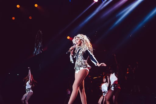 Beyonce performs onstage on her Mrs. Carter World Tour, on Friday, December 20, 2013 at the TD Garden in Boston, Mass. (Photo by Robin Harper/Invision for Parkwood Entertainment/AP)