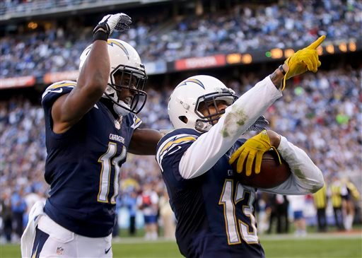San Diego Chargers wide receiver Keenan Allen, right, celebrates his touchdown with teammate wide receiver Eddie Royal against the Oakland Raiders during the first half of an NFL football game on Sunday, Dec. 22, 2013, in San Diego.