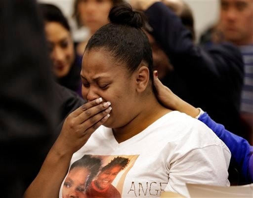 In this Dec. 20, 2013 file photo, Nailah Winkfield, mother of 13-year-old Jahi McMath, cries before a courtroom hearing regarding McMath, in Oakland, Calif.