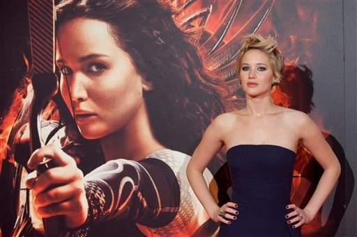 """In this Nov. 13, 2013 file photo, actress Jennifer Lawrence poses for the photographers during the premiere of the movie """"The Hunger Games: Catching Fire"""" at Callao Cinema in Madrid, Spain."""