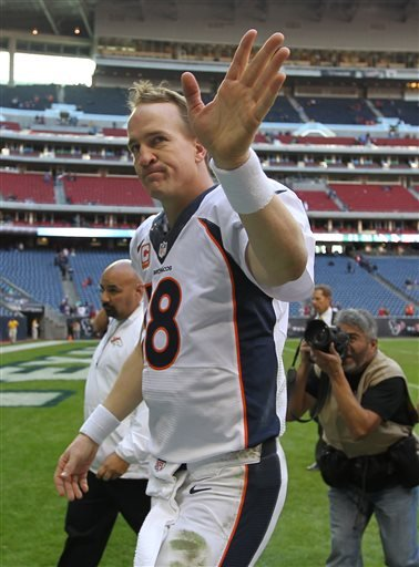 Denver Broncos quarterback Peyton Manning acknowledges the crowd after breaking the single-season touchdown record during an NFL football game against the Houston Texans, Sunday, Dec. 22, 2013, in Houston.