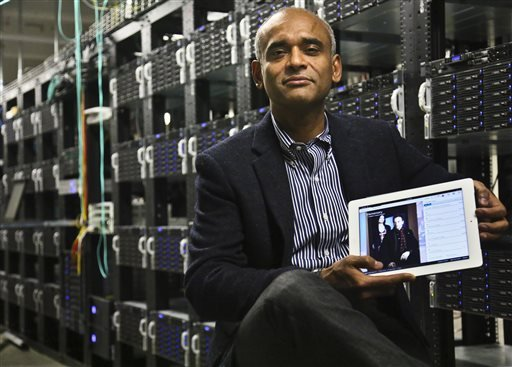 In this Thursday, Dec. 20, 2012, file photo, Chet Kanojia, founder and CEO of Aereo, Inc., shows a tablet displaying his company's technology, in New York.