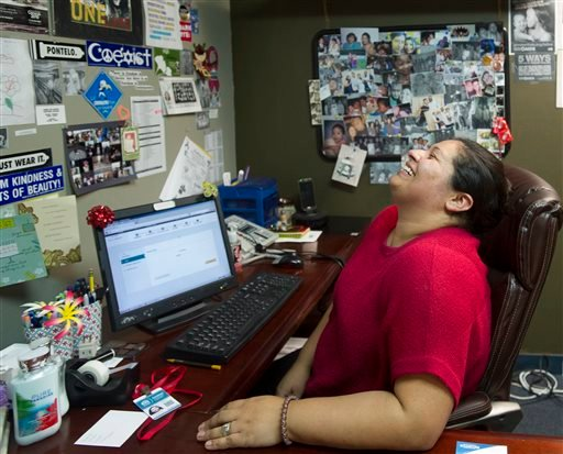 Susan Roberts, a certified enrollment counselor at the AIDS Services Foundation where people receive help signing up in the federal health insurance exchange, reacts in frustration to the Covered California website's multiple logouts and slowness. (AP)