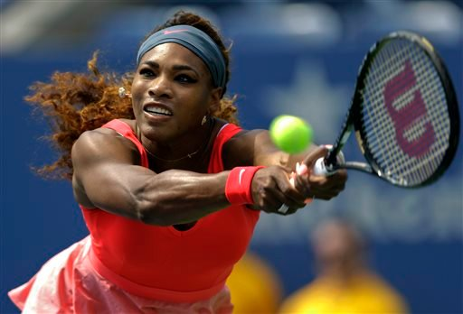 In this Aug. 29, 2013 file photo, Serena Williams returns a shot to Galina Voskoboeva, of Kazakhstan, during the second round of the 2013 U.S. (AP Photo/Kathy Willens, File)