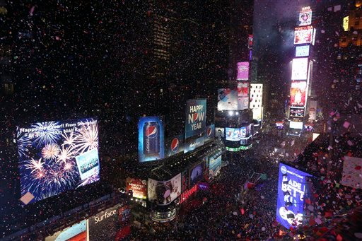 FILE - In this Jan. 1, 2013, file photo, donfetti flies over New York's Times Square after the clock strikes midnight during the New Year's Eve celebration as seen from the Marriott Marquis hotel in New York. (AP)