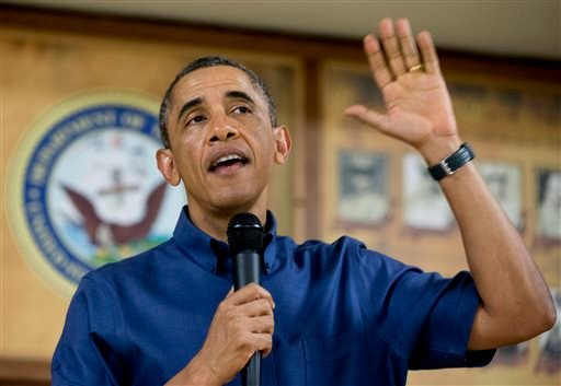 President Barack Obama speaks to members of the military and their families in Anderson Hall at Marine Corps Base Hawaii, Wednesday, Dec. 25, 2013, in Kaneohe Bay, Hawaii. The first family is in Hawaii for their annual holiday vacation. (AP Photo)