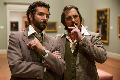 "In this film image released by Sony Pictures, Bradley Cooper, left, as Richie Dimaso and Christian Bale as Irving Rosenfeld talk in a gallery at the Frick Museum in a scene from Columbia Pictures' ""American Hustle."""