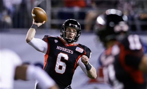 Northern Illinois quarterback Jordan Lynch throws a pass against Utah State during the first half of the Poinsettia Bowl NCAA college football game Thursday, Dec. 26, 2013, in San Diego. (AP Photo/Lenny Ignelzi)