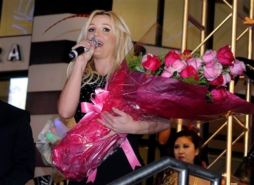 "FILE - This Dec. 3, 2013 file photo shows singer Britney Spears speaking to the crowd after arriving at Planet Hollywood Resort & Casino before the debut of her Las Vegas residency ""Britney: Piece of Me"" in Las Vegas. (AP)"
