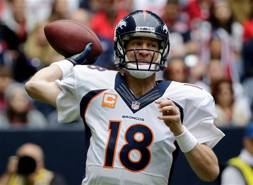 In this Dec. 22, 2013, file photo, Denver Broncos' Peyton Manning throws during the first quarter of an NFL football game against the Houston Texans in Houston.