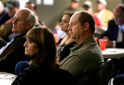 Robert Payne, center right, operator of RPA Associates sits with over 100 first responders and other business owners at a meeting headed by state fire marshal Chris Connealy, Thursday, Dec. 12, 2013, in Clifton, Texas. (AP Photo/Tony Gutierrez)
