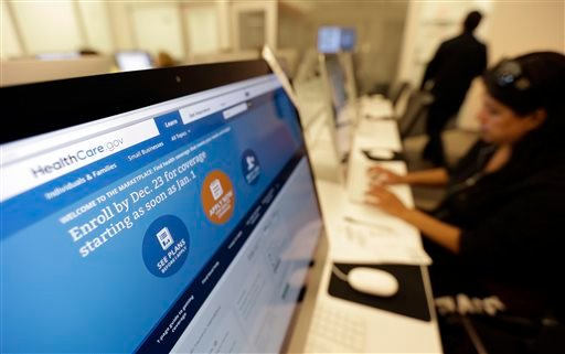 In this Dec. 11, 2013 file photo, Rosemary Cabelo uses a computer at a public library to access the Affordable Health Care Act website, in San Antonio.