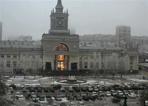 In this photo made by a public camera and made available by the Associated Press Television News the flash of an explosion illuminates the entrance to Volgograd railway station in Volgograd Russia on Sunday, Dec. 29, 2013.