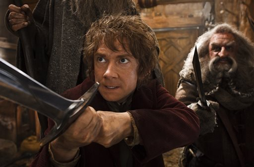 """This image released by Warner Bros. Pictures shows Martin Freeman, left, and John Callen in a scene from """"The Hobbit: The Desolation of Smaug."""