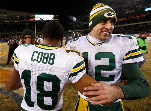 Green Bay Packers quarterback Aaron Rodgers (12) celebrates with wide receiver Randall Cobb (18) after an NFL football game against the Chicago Bears, Sunday, Dec. 29, 2013, in Chicago.