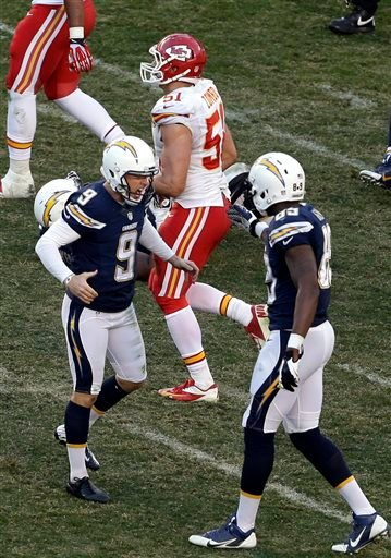 San Diego Chargers kicker Nick Novak (9) celebrates his winning field goal kick with teammate tight end Ladarius Green after defeating the Kansas City Chiefs in overtime during an NFL football game, Sunday, Dec. 29, 2013, in San Diego.