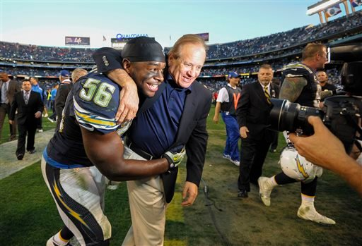San Diego Chargers president Dean Spanos, right, celebrates with inside linebacker Donald Butler (56) after an NFL football game against the Kansas City Chiefs on Sunday, Dec. 29, 2013, in San Diego.