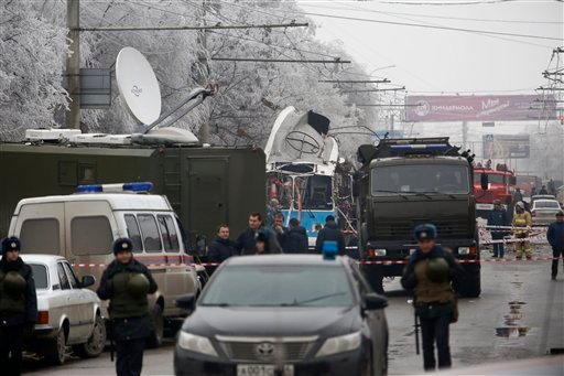 Military vehicles surround a wreckage of a trolleybus, in Volgograd, Russia, Monday, Dec. 30, 2013.