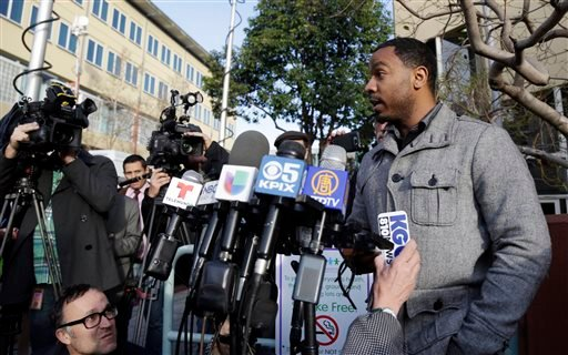 Omari Sealey makes a statement for the media on the condition of his niece Jahi McMath on Monday, Dec. 30, 2013, in Oakland, Calif. (AP Photo/Marcio Jose Sanchez)